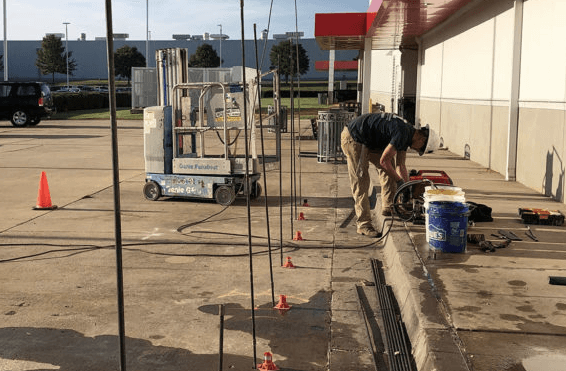 Helms Polyfoam contractor repairing and lifting concrete parking lot
