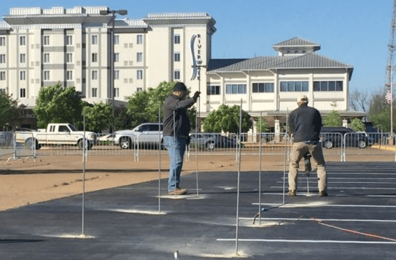 Helms Polyfoam contractors drilling holes in parking lot